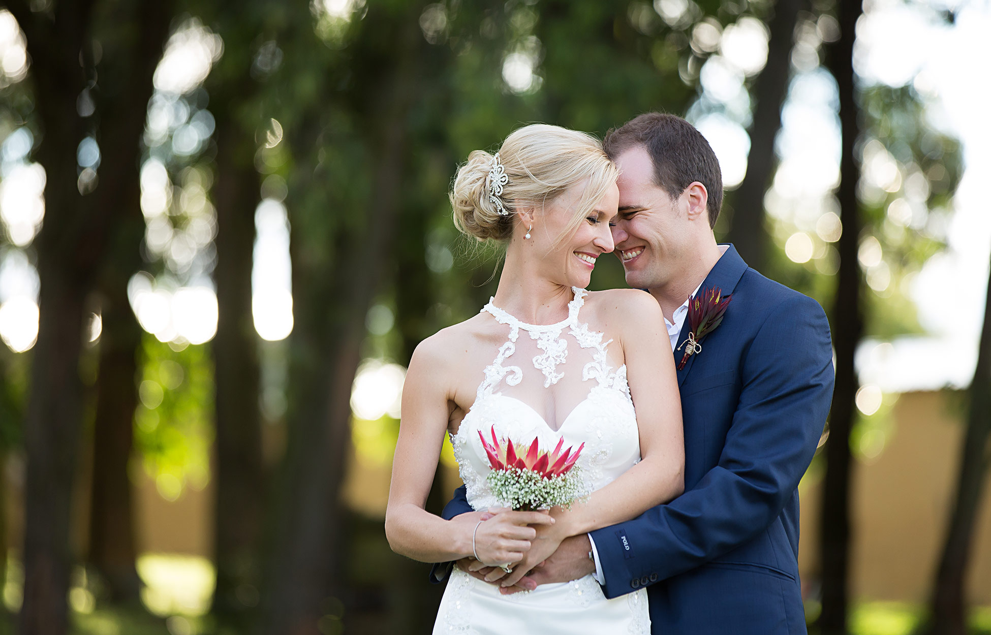 bride and groom with protea bouquet